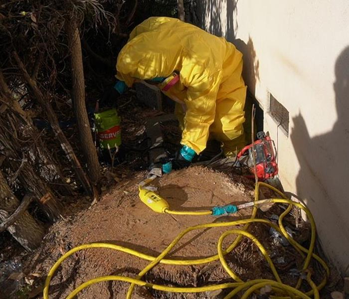 SERVPRO Tech. in Hazmat Going Into Crawlspace